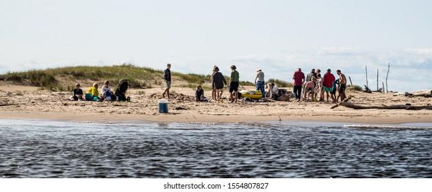 Riga, Latvia - 26.08.2017 Group of people at River Coast