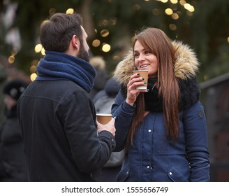 Riga, Latvia - 31.12.2018. Girl drinks coffe with her friend
