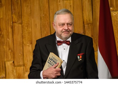 RIGA, LATVIA. 8th of July 2019. Andris Vilks, director of LNB with received book from President, during Reception in honour of the inauguration of President of Latvia Mr Egils Levits.