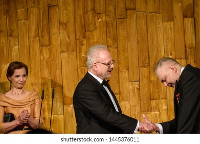 RIGA, LATVIA. 8th of July 2019. Egils Levits giving gift for Andris Vilks, director of Latvian National Library, during Reception in honour of the inauguration of President of Latvia Mr Egils Levits