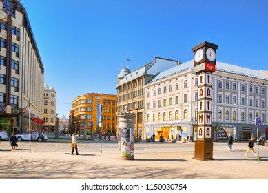 Riga, Latvia - April 12, 2018: The Laima watches (Laimas pulkstenis) are street watches of the original tower design located in the center of Riga.