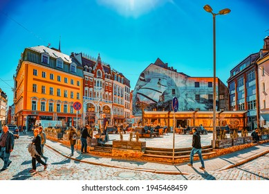 Riga, Latvia - April 12, 2018:  Dome Square (Doma laukums) near the Dome Cathedral- Medieval Lutheran church with elements of Romanesque architecture.