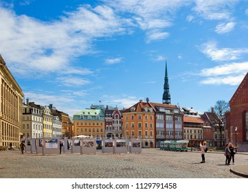 RIGA, LATVIA - APRIL 19, 2018: Dome square with exhibition, old building and people