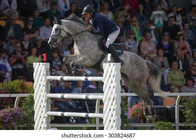 RIGA, LATVIA - Aug  2: Rider Girts BRICIS (LAT) with horse CARLORD (103)  jumps over obstacle at FEI World Cup Qualifying competition CSI2*-W on August 2, 2015 in Riga