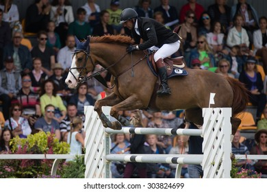 RIGA, LATVIA - Aug  2: Rider Rein PILL (EST) with horse A BROK (56) jumps over obstacle at FEI World Cup Qualifying competition CSI2*-W and Qualifier for 2016 Olympic Games on August 2, 2015 in Riga