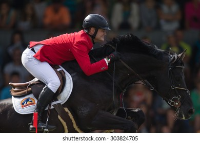 RIGA, LATVIA - Aug 2: Rider Oliver KARMA (EST) with horse VANCO Z (55)  jumps over the obstacle at FEI World Cup Qualifying competition CSI2*-W on August 2, 2015 in Riga