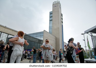 Riga, Latvia – August 18, 2018. Horizontal image of people dancing Argentine tango during BIG RIGA TANGO Flashmob performed at Riga's Central Station Square during Riga City Festival 2018.