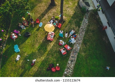 Riga, Latvia august 2, 2018 Aerial view on garden party in summer evening, people partying in garden