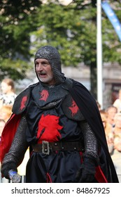 RIGA, LATVIA - AUGUST 21: Gerard Naprous the leader of The Devils Horsemen stunt team in black armor during Riga Festival on August 21, 2011 in Riga, Latvia