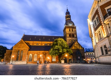 Riga, Latvia - August 22, 2017 : Beautiful evening view on Riga Cathedral (Dome Cathedral) with glowing lights, Riga, Latvia. The cathedral is one of the most recognizable landmarks in Latvia