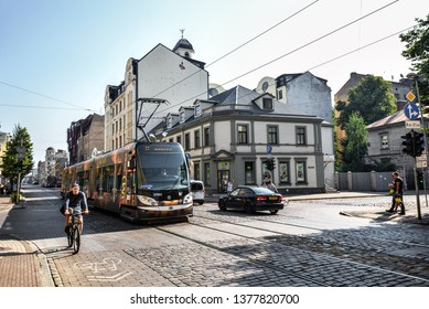 Riga, Latvia - August 23, 2017 : View on old colorful buildings and streets of Riga, modern tram, Latvia. Architecture in Riga city center.