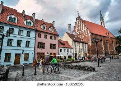 Riga, Latvia - August 23, 2017 : Beautiful view on old colorful buildings and streets of Riga, Latvia. Architecture in Riga city center.