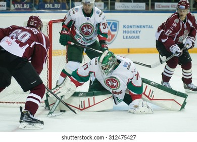 RIGA, LATVIA - AUGUST 25: Goaltender of Ak Bars Emil Garipov (77) saves the goal  in KHL game between Dinamo Riga and Ak Bars played on AUGUST 25, 2015 in Arena Riga