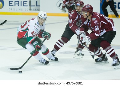 RIGA, LATVIA - AUGUST 25: Guntis Galvins (58) and Tomas Kundratek (84) tries to stop Oscar Moller (45) in KHL game between Dinamo Riga and AK Bars played on AUGUST 25, 2015 in Arena Riga