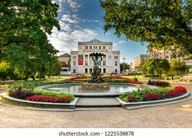 Riga, Latvia - August 26, 2017: Latvian National Academic Opera and Ballet Theatre and facade square with fountain and sculpture group of Nymph, in Riga - the capital of Latvia, EC
