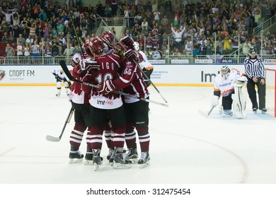 RIGA, LATVIA - AUGUST 27: Players of Dinamo Riga celebrate the goal  in KHL game between Dinamo Riga and Severstal Cherepovets played on AUGUST 27, 2015 in Arena Riga