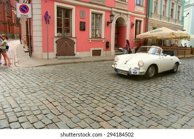 RIGA, LATVIA - AUGUST 9: Annual parade of old cars at Riga City Festival in Riga on August 9, 2010 in Latvia.