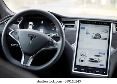 RIGA, LATVIA - DECEMBER 1, 2015: The interior of a Tesla Model S electric car with its large touchscreen dashboard.