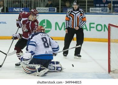 RIGA, LATVIA - DECEMBER 10: Andris Dzerins (25)  plays in front of the goalie Ivan Lisutin (84) in KHL game between Dinamo Riga and Neftekhimik Nizhnekamsk played on DECEMBER 10, 2015 in Arena Riga
