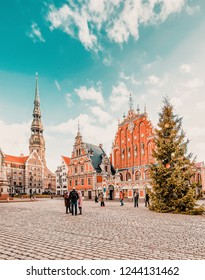 Riga, Latvia - December 26, 2015: People at House of Blackheads with Christmas tree in the Town Hall square in Riga in Latvia in winter.