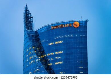 Riga, Latvia - December 27, 2017: Swedbank Modern office business skyscrapers in Riga in Latvia. In the evening