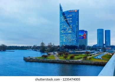 Riga, Latvia - December 27, 2017: Swedbank Modern office business skyscrapers at Daugava River in Riga in Latvia. In the evening