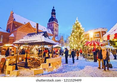 Riga, Latvia - December 28, 2014: People enjoy Christmas market in winter Riga in Latvia.