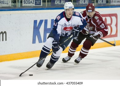 RIGA, LATVIA - DECEMBER 28: Edgars Kulda (32) tries to catch Evgeny Mozer (11) in KHL game between Dinamo Riga and Torpedo Nizhny Novgorod played on DECEMBER 28, 2015 in Arena Riga