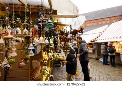 RIGA, LATVIA - DECEMBER 29, 2018:Christmas market at Dome square in Old Riga (Latvia). Dome Square at Christmas market in winter Riga in Latvia.