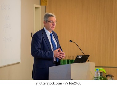 RIGA, LATVIA - DECEMBER 8, 2017: Karlis Sadurskis , Minister of Education and Science in Latvia, speaking at the conference of Latvian Geospatial Technology association