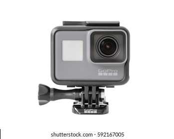 RIGA, LATVIA - February 24, 2017: GoPro camera HERO5 Black combines 4K video, one-button simplicity and voice control all in a small, waterproof design. Isolated on white background.