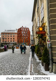 Riga / Latvia - Jan 2018: The frozen streets in Riga Old Town at day at Cristmas time with modern and ancient buildings. Winter in Latvia, Baltic States.
