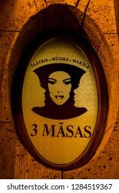 "Riga / Latvia - Jan 2018: The vintage contour of 3 faces in art nouveau. Translation is ""3 masks""."