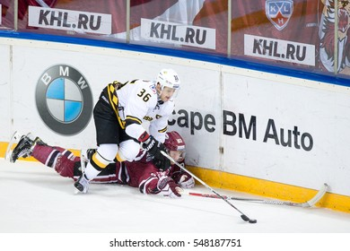 RIGA, LATVIA - JANUARY 3: Anton Sizov (36) pins down on ice Georgs Golovkovs (83) in the KHL game between Dinamo Riga and Severstal Cherepovets, played on January 3, 2017 in Arena Riga
