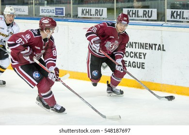 RIGA, LATVIA - JANUARY 3: Gints Meija (87) and Roberts Lipsbergs (38) in the KHL regular championship game between Dinamo Riga and Severstal Cherepovets, played on January 3, 2017 in Arena Riga