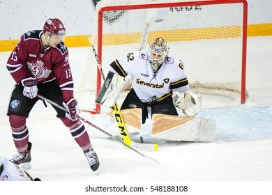 RIGA, LATVIA - JANUARY 3: Goalie of Severstal Cherepovets Roman Smiryagin (62) saves the goal in the KHL game between Dinamo Riga and Severstal Cherepovets, played on January 3, 2017 in Arena Riga