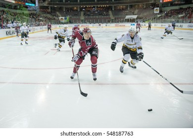 RIGA, LATVIA - JANUARY 3: Miks Indrasis (70) and Adam Masuhr (8) in the KHL regular championship game between Dinamo Riga and Severstal Cherepovets, played on January 3, 2017 in Arena Riga