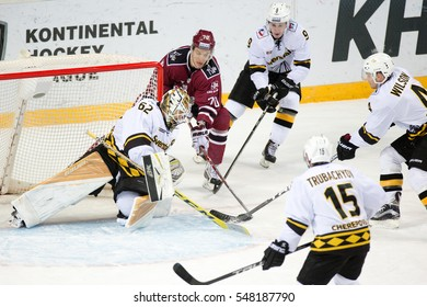 RIGA, LATVIA - JANUARY 3: Miks Indrasis (70) tries to score to goalie Roman Smiryagin (62) in the KHL game between Dinamo Riga and Severstal Cherepovets, played on January 3, 2017 in Arena Riga