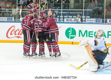 RIGA, LATVIA - JANUARY 3: Players of Dinamo Riga celebrate the goal in the KHL regular championship game between Dinamo Riga and Severstal Cherepovets, played on January 3, 2017 in Arena Riga