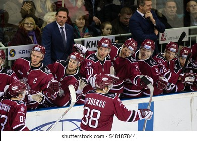 RIGA, LATVIA - JANUARY 3: Players and coaches celebrate the goal of Dinamo Riga in the KHL game between Dinamo Riga and Severstal Cherepovets, played on January 3, 2017 in Arena Riga