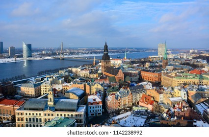 Riga / Latvia — January 30, 2015: the skyline of the old town and the historic center of Riga with the Riga Cathedral, Riga castle, St. James's Cathedral and the Daugava river