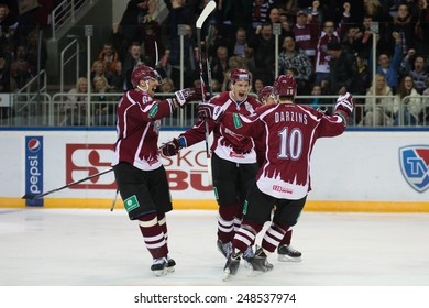 RIGA, LATVIA - JANUARY 30: Milan Jurcina (68), Miks Indrasis (70) and Lauris Darzins (10) celebrate the goal  in KHL game between Dinamo Riga and Medvescak Zagreb on JANUARY 30, 2015 in Arena Riga