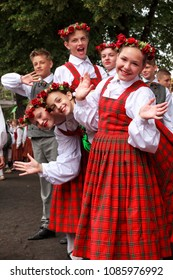 RIGA, LATVIA - JULY 11, 2015: Young Dancers in traditional costumes behind scene waiting for time to perform at Grand Folk dance concert of Latvian Youth Song and Dance Festival in the Daugava Stadium