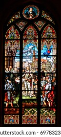RIGA, LATVIA - JULY 11, 2017: Stained glass windows in Riga Dome Cathedral, depicting various historical and biblical scenes.