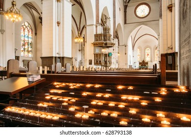 Riga, Latvia - July 2, 2016: Group Of Candles In The Riga Dom Dome Cathedral. Interior Of Church.