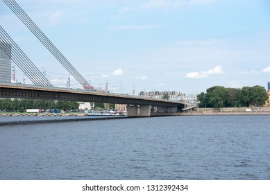 Riga, Latvia, July 2016. View of famous Vansu Tilts (Cable-Stayed Bridge) in bright sunny day. The Daugava river or Western Dvina River. A panoramic image of the Vansu bridge that spans the Daugava