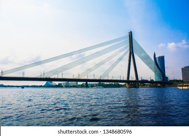 RIGA, LATVIA - JULY 25, 2016 : Vansu bridge (former Gorky bridge) over Daugava river in Riga on a beautiful summer day, Latvia. Modern wire / cable bridge architecture shot in Riga, Latvia.