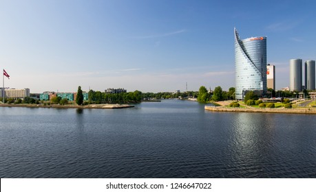 Riga, LATVIA - JULY 31, 2018 -  Daugava River with buildings and vegetation