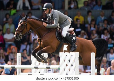 RIGA, LATVIA - JULY 31: Andrius PETROVAS jumps over the obstacle with horse VENERA, World Cup competition, Grand Prix Riga 2016, CSI2*-W, CSIYH1* on JULY 31, 2016 in Kleisti equestrian sports center