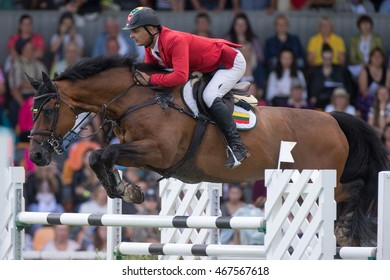 RIGA, LATVIA - JULY 31: Danielius GUTKAUSKAS jumps over the obstacle with horse TOM RIDDLE S, World Cup competition, Grand Prix Riga 2016, CSI2*-W, CSIYH1* on JULY 31, 2016 in Kleisti sports center